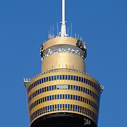 The top of Sydney's Centrepoint Tower with a clear blue sky in the background