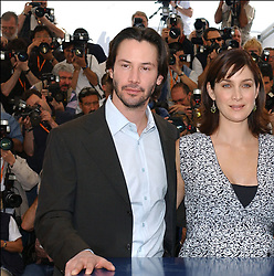 © Arnal-Hahn-Nebinger/ABACA. 45620-1. Cannes-France, 15/05/2003. US actors Keanu Reeves, Carrie-Anne Moss and Laurence Fishburne pose at a photocall for their film Matrix Reloaded presented out of competition at the 56th Cannes Film Festival.  Cannes Film Festival Festival de Cannes Festival du Film de Cannes Cannes Film Festival Fishburne Laurence Fishburne Lawrence Fishburne Laurence Fishburne Lawrence Matrix Reloaded Matrix 2 The Matrix Reloaded Moss Carrie-Anne Moss Carrie-Anne Reeves Keanu Reeves Keanu Presentation de film Presentation de serie Movie Screening<br /> Photocall<br /> Photo call Cannes France Frankreich Provence-Alpes-Côte d'Azur Provence-Alpes-Cote d'Azur Horizontal Landscape Plan americain Half length  | 45620_01