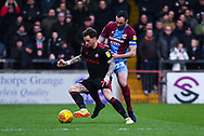 Chris Maguire of Sunderland (7) ands Rory McArdle of Scunthorpe United (23) jostle for the ball during the EFL Sky Bet League 1 match between Scunthorpe United and Sunderland at Glanford Park, Scunthorpe, England on 19 January 2019.