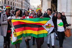 A delegation of Zimbabweans from the weekly Zimbabwe Vigil protest that has been held at Zimbabwe House in London for over 10 years, delivered a petition to Downing Street objecting to the lifting of EU sanctions against the aging Mugabe's regime despite the fact that there have been no political reforms in the country whose large population in the diaspora are denied their right to vote, and where rigging and intimidation are the order of the day in Presidential and Parliamentary elections. PICTURED: Zimbabwe Vigil protesters march to Downing Street to deliver their petition.