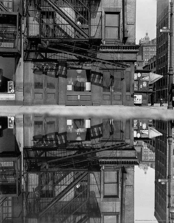 Mirror image of street-corner scene, Burling Slip and South St, New York, USA, 1921