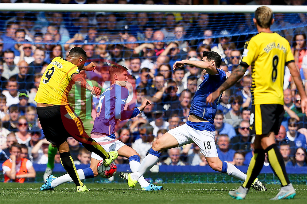 Watford's Troy Deeney has a shot blocked by Everton's John Stones and Gareth Barry - Mandatory byline: Matt McNulty/JMP - 07966386802 - 08/08/2015 - FOOTBALL - Goodison Park -Liverpool,England - Everton v Watford - Barclays Premier League