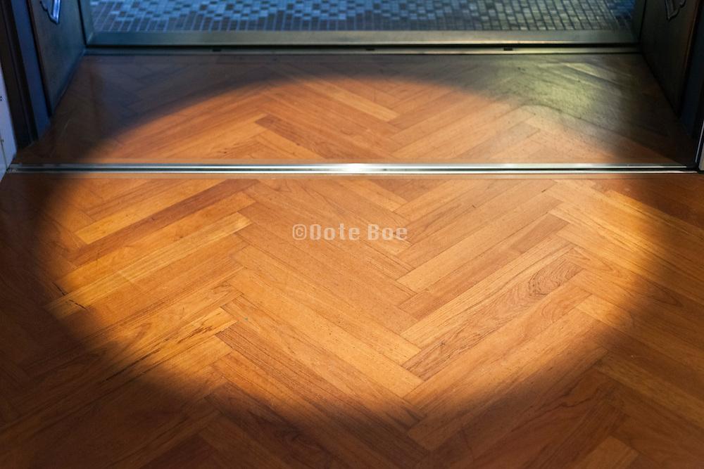 sliding door opening and parquet floor with spotlight