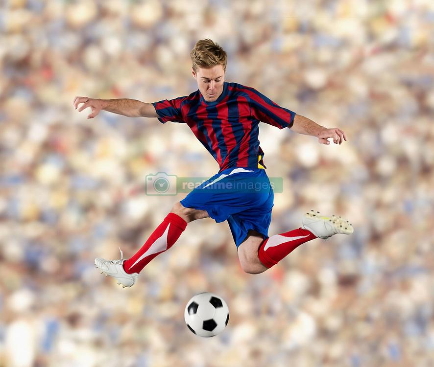 Soccer player kicking ball in air (Credit Image: © Image Source/Pete Saloutos/Image Source/ZUMAPRESS.com)