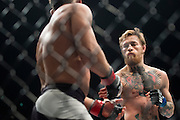 Conor McGregor throws a punch against Chad Mendes during UFC 189 at the MGM Grand Garden Arena in Las Vegas, Nevada on July 11, 2015. (Cooper Neill)