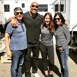 """Dwayne Johnson releases a photo on Instagram with the following caption: """"Great family set visit on #SKYSCRAPER up here in Vancouver with Jeff Shell and his lovely wife, Laura and their awesome daughter, Anna. \nJeff is Universal's Chairman of global film operations so I enjoy picking his brain about our business and where we're trending. \nAlso had great chats about the FAST \u0026 FURIOUS franchise and the much anticipated HOBBS spinoff. Got some big plans you guys'll love. \nThe best part of the meeting was not only getting his wife Laura's point of view on projects - because mom's rule the world - but having their 14yr old daughter, Anna say, \"""". Photo Credit: Instagram *** No USA Distribution *** For Editorial Use Only *** Not to be Published in Books or Photo Books ***  Please note: Fees charged by the agency are for the agency's services only, and do not, nor are they intended to, convey to the user any ownership of Copyright or License in the material. The agency does not claim any ownership including but not limited to Copyright or License in the attached material. By publishing this material you expressly agree to indemnify and to hold the agency and its directors, shareholders and employees harmless from any loss, claims, damages, demands, expenses (including legal fees), or any causes of action or allegation against the agency arising out of or connected in any way with publication of the material."""