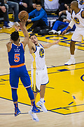 Golden State Warriors guard Klay Thompson (11) challenges a jump shot by New York Knicks guard Courtney Lee (5) at Oracle Arena in Oakland, Calif., on May 2, 2017. (Stan Olszewski/Special to S.F. Examiner)