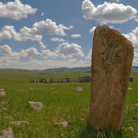 A mysterious 2700+ year-old, bronze age Deer Stone stands by sheep pastures near Lake Erkhel & Muren, Mongolia.