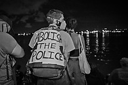 After  thousands gathered at a rally outside of Jackson Square in New Orleans on June 5, 2020, on the seventh day of protests over the police killing of George Floyd in Minneapolis on May 25, many headed to the Mississippi River to reflect. The protests were spearheaded by the New Orleans Workers Group and Take 'Em Down NOLA .