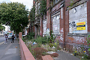 Derelict and boarded up building in Balsall Heath on 3rd August 2020 in Birmingham, United Kingdom. This area has a lot of run down and closed properties and the streets litter strewn.