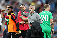 Football - 2018 / 2019 Premier League - Burnley vs. Manchester United<br /> <br /> Manchester United manager Jose Mourinho  gives a thumbs up towards the Manchester United fans following the final whistle at Turf Moor.<br /> <br /> COLORSPORT/PAUL GREENWOOD