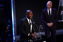 A friend of Francis Kone accepts the award on his behalf for FIFA Fair Play during the Best FIFA Football Awards 2017 at the Palladium Theatre, London.