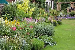 Summer border  in John Massey's garden at Ashwood Nurseries