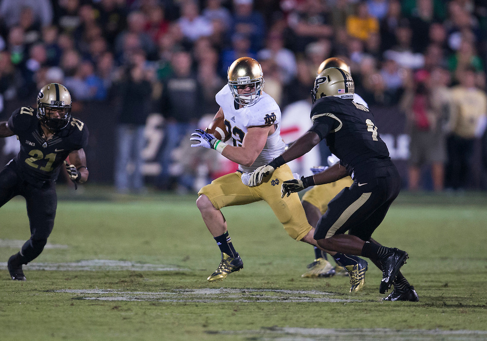 September 14, 2013:  Notre Dame running back Cam McDaniel (33) runs the ball as Purdue defensive back Anthony Brown (9) defends during NCAA Football game action between the Notre Dame Fighting Irish and the Purdue Boilermakers at Ross-Ade Stadium in West Lafayette, Indiana.  Notre Dame defeated Purdue 31-24.