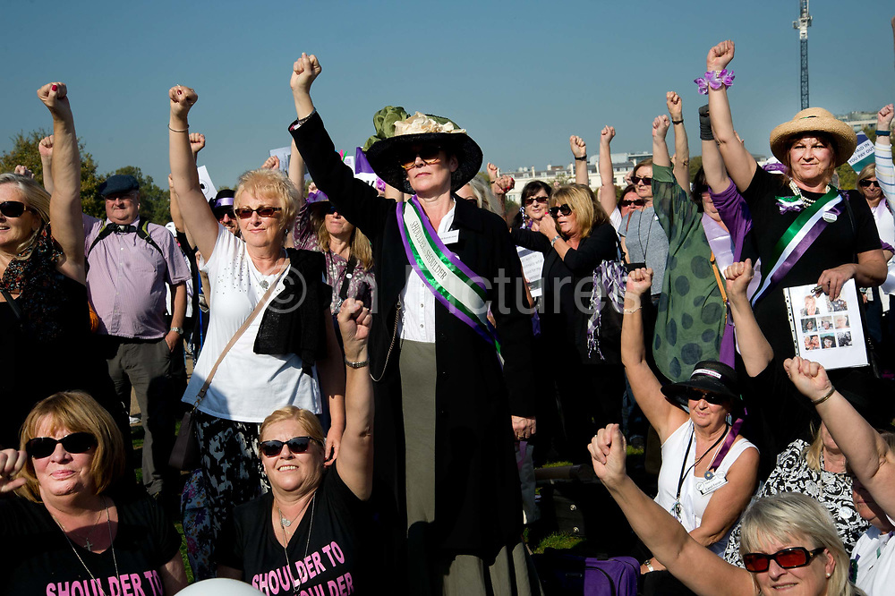 Women born in the 1950s held a Day of Action to draw attention to the women affected by the rise of the state pension age, from 60 to 66, organised by different groups including WASPI Women Against State Pension Inequality Campaign, BackTo60, and We Paid In You Pay Out on October 10th 2018 in London, United Kingdom. A group, mainly women, raise their fists.