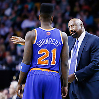 26 March 2013: New York Knicks head coach Mike Woodson talks to New York Knicks small forward Iman Shumpert (21) during the New York Knicks 100-85 victory over the Boston Celtics at the TD Garden, Boston, Massachusetts, USA.