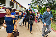 16 JUNE 2014 - ARANYAPRATHET, THAILAND: Cambodian migrants walk out of the train station in Aranyaprathet, Thailand. More than 150,000 Cambodian migrant workers and their families have left Thailand since June 12. The exodus started when rumors circulated in the Cambodian migrant community that the Thai junta was going to crack down on undocumented workers. About 40,000 Cambodians were expected to return to Cambodia today. The mass exodus has stressed resources on both sides of the Thai/Cambodian border. The Cambodian town of Poipet has been over run with returning migrants. On the Thai side, in Aranyaprathet, the bus and train station has been flooded with Cambodians taking all of their possessions back to Cambodia. PHOTO BY JACK KURTZ