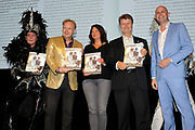 Presentatie van de vernieuwde Gay Krant tijdens de Premiere Behind the Candelabra , een film over Liberace in Theater Pathe Tuschinski, Amsterdam.<br /> <br /> Op de foto:   het eerste nummer van de vernieuwde GayKrant wordt aan Boris Dittrich (Human Rights Watch), Eunice den Hoedt (COC) en Frits Huffnagel overhandigd door hoofdredacteur Edwin Reinerie