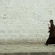 People walking around Palace praying in the city of Lhasa. Tibet.