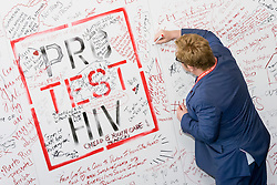 """""""Young people are being left out and left behind in the AIDS response and it needs to stop here and now."""" said Sir Elton John, as he and Prince Harry joined forces at the International AIDS Conference 2016 in Durban, South Africa, on Thursday 21 July. Sir Elton then wrote on the """"Pro Test"""" wall the phrase """"Love is vital, July 2016""""."""