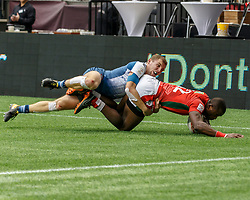 March 10, 2018 - Vancouver, British Columbia, U.S. - VANCOUVER, BC - MARCH 10: Willy Ambaka (#12) of Kenya tackled by France player during Game # 3- Kenya vs France Pool C match at the Canada Sevens held March 10-11, 2018 in BC Place Stadium in Vancouver, BC. (Photo by Allan Hamilton/Icon Sportswire) (Credit Image: © Allan Hamilton/Icon SMI via ZUMA Press)