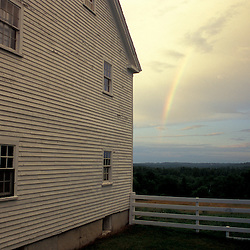 New Gloucester, ME.A rainbow as seen from the recreation center (Boy's Shop) at the Sabbathday Lake Shaker Village.