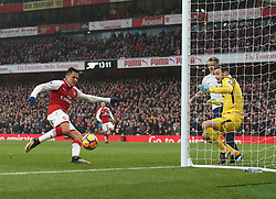 18 November 2017 London : Premier League Football : Arsenal v Tottenham Hotspur - Alexis Sanchez pounces to scorethe second goal for Arsenal past Tottenham goalkeeper Hugo Lloris.<br /> (photo by Mark Leech)