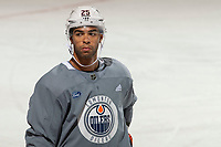 KELOWNA, BC - SEPTEMBER 23: Darnell Nurse #25 of the Edmonton Oilers stands at the bench during practice at Prospera Place on September 23, 2019 in Kelowna, Canada. (Photo by Marissa Baecker/Shoot the Breeze)