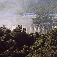 South America, Argentina, Iguacu Falls. Mist rises amongst the trees at Iguacu Falls.
