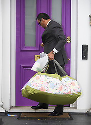 © Licensed to London News Pictures. 01/06/2016. London, UK. Bags carrying food and other items being taken from the London home of Rolling Stones guitarist Ronnie Wood, who turned 69 today (Weds) and had twins  on May 30th with his wife Sally Humphreys.  Photo credit: Ben Cawthra/LNP