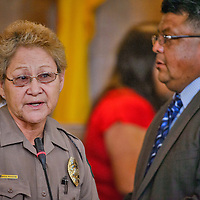 Officer Gladys Antone speaks to teh coucil after being recgnised by Chairperson of the Law & Order Committee Edmund Yazzie during the 23rd Navajo Nation Council Summer Session on Monday in Window Rock .