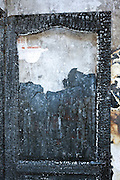 remains of a door in a total burned out residential house