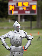 Cornwall-on-Hudson, New York - The New York Military Academy mascot, wearing a suit of armor, stands in front of the scoreboard during a high school football game against the Harvey School on Oct. 17, 2009.