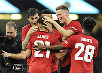 Football - 2019 (ICC) International Champions Cup (pre-season friendly) - Manchester United vs. AC Milan<br /> <br /> Daniel James (scorer of the winning Penalty in the shoot out, celebrates with Scott McTomiaay and Victor Lindelof, at The Principality (Millennium) Stadium, Cardiff.<br /> <br /> COLORSPORT/ANDREW COWIE