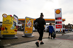 © Licensed to London News Pictures. 30/09/2020. London, UK. Members of public walk past a Shell petrol station in London. Royal Dutch Shell Plc will cut up to 9,000 jobs as part of a major overhaul to shift the oil and gas giant to low-carbon energy. Shell will cut the dividend payments to its shareholder for the first time since World War 2. Photo credit: Dinendra Haria/LNP