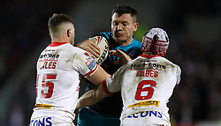 Leeds Rhinos Brett Ferres is tackled by St Helens Saints' Morgan Knowles (left) and Theo Fages (right) during the Betfred Super League match at the Totally Wicked Stadium, St Helens.