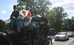 © Licensed to London News Pictures. 21/06/2018. London, UK. Racegoers in a carriage at Ladies Day at Royal Ascot at Ascot racecourse in Berkshire, on June 21, 2018. The 5 day showcase event, which is one of the highlights of the racing calendar, has been held at the famous Berkshire course since 1711 and tradition is a hallmark of the meeting. Top hats and tails remain compulsory in parts of the course. Photo credit: Ben Cawthra/LNP