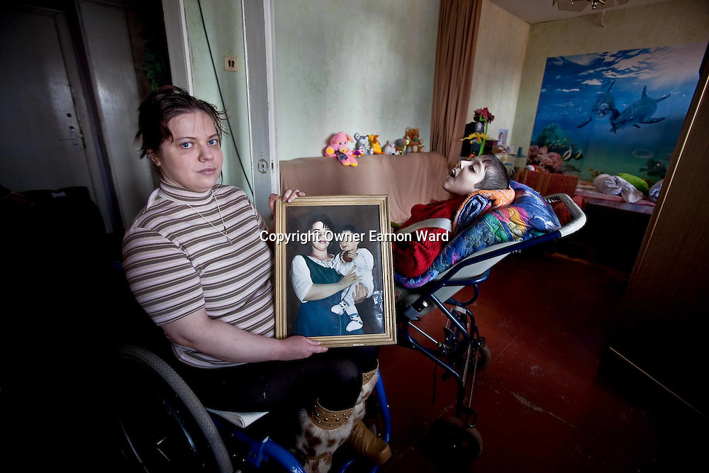 Wheelchair bound Sasha cares for her Son who ,though born healthy suffered brain damage following a tonsilectomy without anesthetic in Gomel,Southern Belarus.