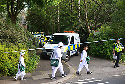 © Licensed to London News Pictures. 03/06/2021. Rochdale, UK. Emergency services on Foxholes Road in Rochdale where police are seen outside All Saints Hamer and Christ Church Healey Vicarage . It's being reported locally that body bags were seen being removed from the scene this afternoon (Thursday 3rd June 2021). Photo credit: Joel Goodman/LNP