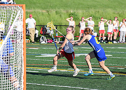 Laconia's Skyler Tautkus makes her way to the net during a game against Kearsarge at Fitzgerald Field in Laconia on Thursday, June 1, 2017.  (Alan MacRae for the Laconia Daily Sun)