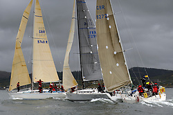 The Clyde Cruising Club's Scottish Series held on Loch Fyne by Tarbert. .Day 4 Racing with a wet Southerly to start clearing up for the last race...Classes converge on the leeward mark...GBR9740R ,Sloop John T ,Iain & Graham Thomson ,CCC ,Swan 40, FRA37296, Salamander XXI ,John Corson ,CCC , First 35, GBR8272, Enigma, Howard Morrison, CCC, Sigma 38.