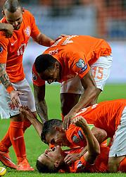 10-10-2014 NED: UEFA EK Kwalificatie Nederland - Kazachstan<br /> Ibrahim Afellay scoort de 2-1 en viert zijn feestje met Robin van Persie, Leroy Fer, Wesley Sneijder