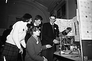 05/01/1965.01/05/1965.5th January 1965.The Aer Lingus Young Scientist Exhibition at the.Manson House..Cornelius Hegarty (Colaiste Chriost Ri Cork) who won 3rd prize in the senior physics, trying out his oscilliscope with his brother Michael (also a competitor in junior physics). With the boys are Breda Logan (Loreto Abbey, Dalkey) and Kathy Carey (Sion Hill Convent Blackrock)who were also competitiors.
