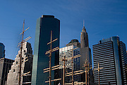 Trade by sea changes to stock trading online - New York's seafaring past. Sailing ship masts at South Street Seaport, Manhattan, with a backdrop of financial corporation skyscrapers.