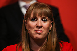 © Licensed to London News Pictures. 09/05/2017. Manchester, UK. Shadow secretary of state for education Angela Rayner watches on as Labour Leader Jeremy Corbyn addresses supporters and the media at a rally in Manchester to launch the party's general election election campaign. Photo credit : Ian Hinchliffe/LNP