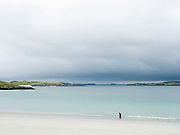 An elderly man walking on the beach at Cnip, Isle of Lewis, Outer Hebrides, Scotland on 15 July 2018