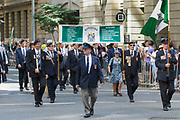 Rhodesia miltary veterans march during Brisbane ANZAC day 2014 parade <br /> <br /> Editions:- Open Edition Print / Stock Image