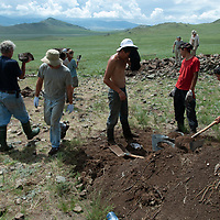 MONGOLIA. Smithsonian Museum archaeology team led by Dr. Bruno Frohlich unearths 2700+ year-old, khirigsur burial mounds at site above Delger River Valley, near Muren.