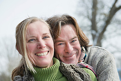 Portrait of couple embracing, smiling, Bavaria, Germany
