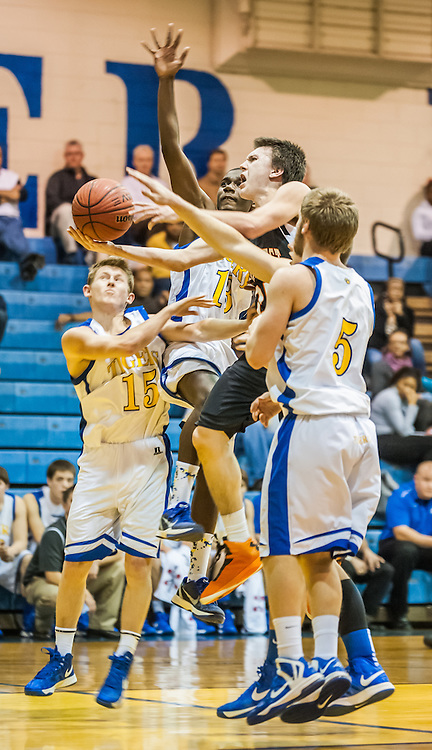 Northwest Cabarrus' Andrew Wheet goes up for a shot against Mount Pleasant's Nathan Chambers Wednesday night at Mount Pleasant High School.